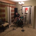 Charlie tuning drums for his drum miking seminar