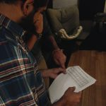 Sandesh Nagaraj discusses chart changes during a recording session at Ultimate Studios, Inc