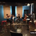 Sandesh Nagaraj conduction the string quartet at a recording session at Ultimate Studios, Inc