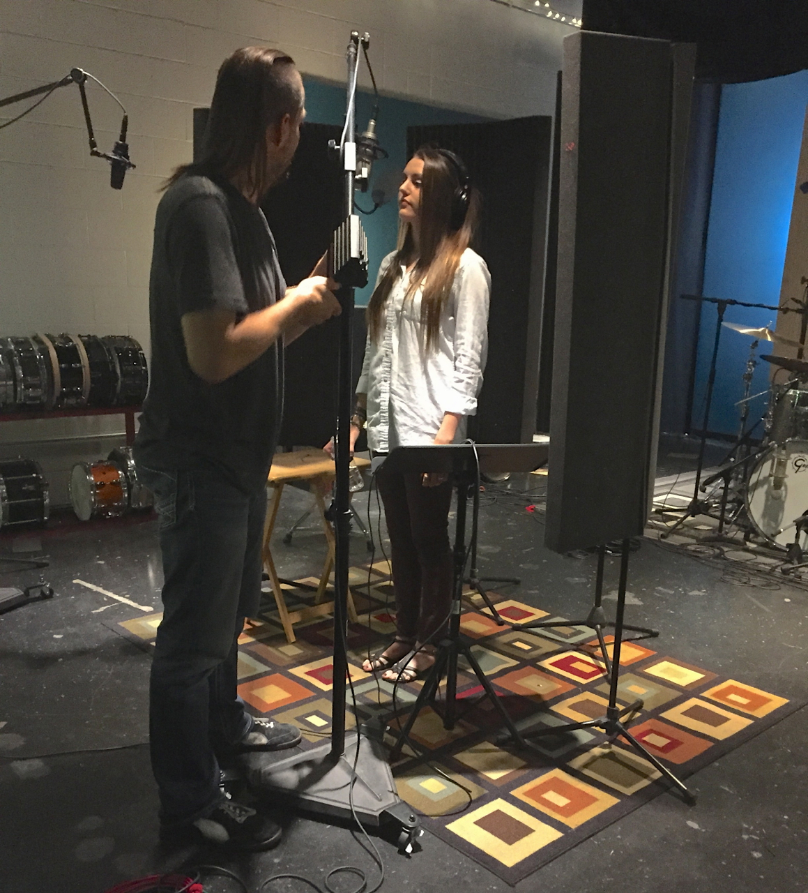 Producer/Engineer Charlie Waymire places microphone for Kalynne Michelle