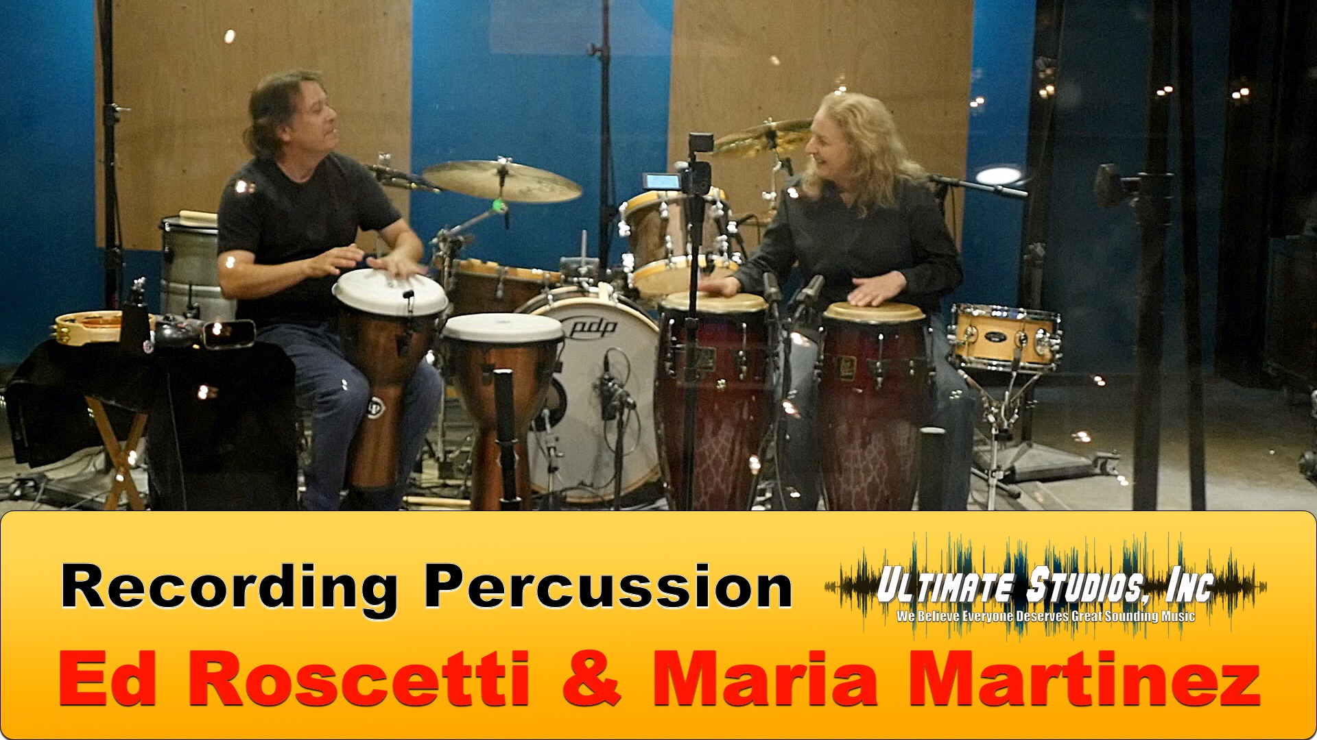 Ed Roscetti and Maria Martinez recording percussion at Ultimate Studios Inc Los Angeles